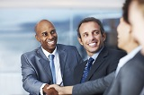 160-African-American-business-man-greeting-a-colleague-during-a-meeting.jpg